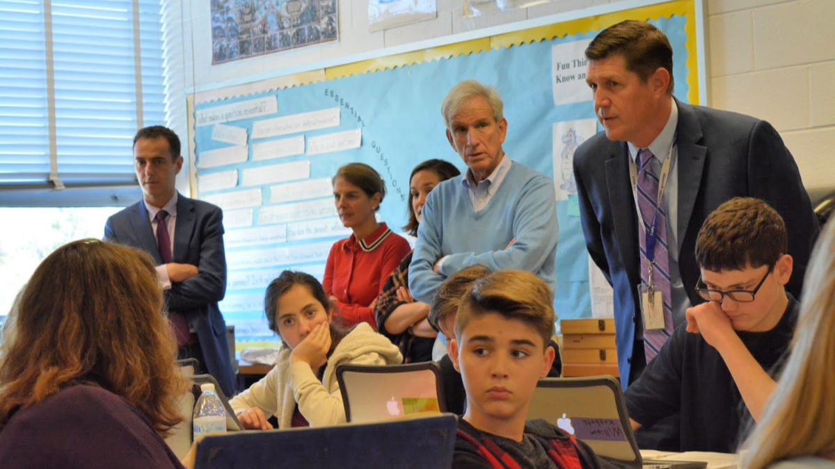 State representatives, school board and Dr Noonan listen to student's answer