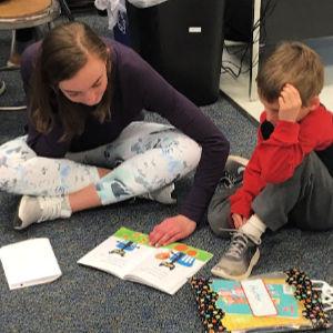 8th grader reads with kindergartner