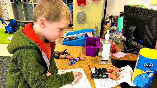 First grader practices persuasive writing
