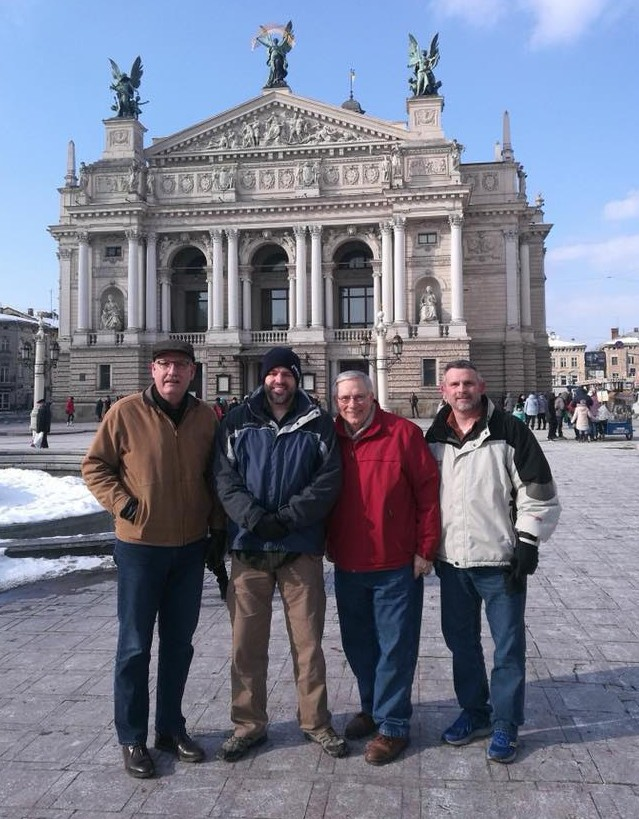 The four of us are standing in downtown Lviv at the Opera House.