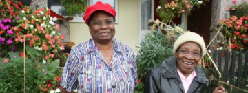 Image of two migrant entrepreneurs in a garden http://www.jrf.org.uk/work/workarea/housing-and-migration