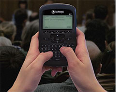 Q2 clicker with hands in a classroom