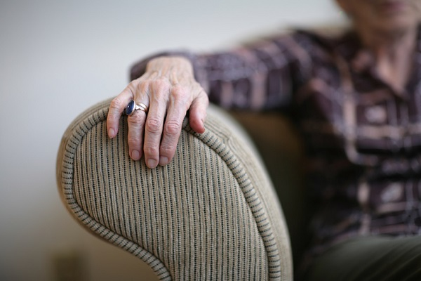 Elderly lady in armchair