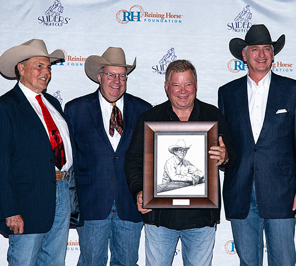 Mike Deer, NRHA President, Gary Carpenter, NRHA Commissioner, and Mark Blake, Reining Horse President, present the Dale Wilkinson Lifetime Achievement Award to actor William Shatner for his work in supporting the equine industry and reining.