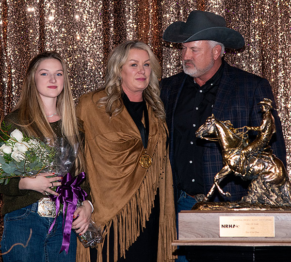 "Bill Bradley of Mount Sterling, Kentucky, was inducted posthumously into the NRHA Hall of Fame. Accepting the award are his stepdaughter Gabriella ""Boo"" Kammerer and wife, Gloria Bradley, along with friend and Reining Horse Foundation Board member Rick Clark."