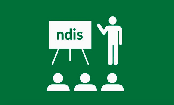 """person standing with whiteboard that reads """"NDIS""""."""