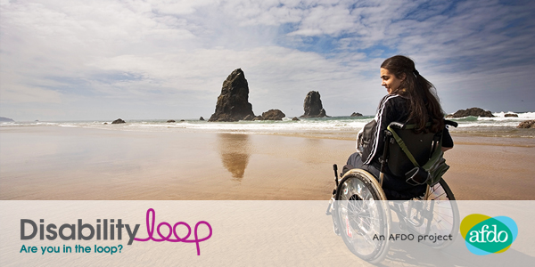 A young woman on the beach in a wheelchair. Logos that read: Disability Loop - Are you in the loop? An AFDO project - AFDO.