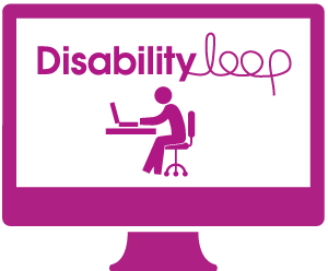 A monitor displaying the Disability Loop logo, and person sitting at a desk using a computer.