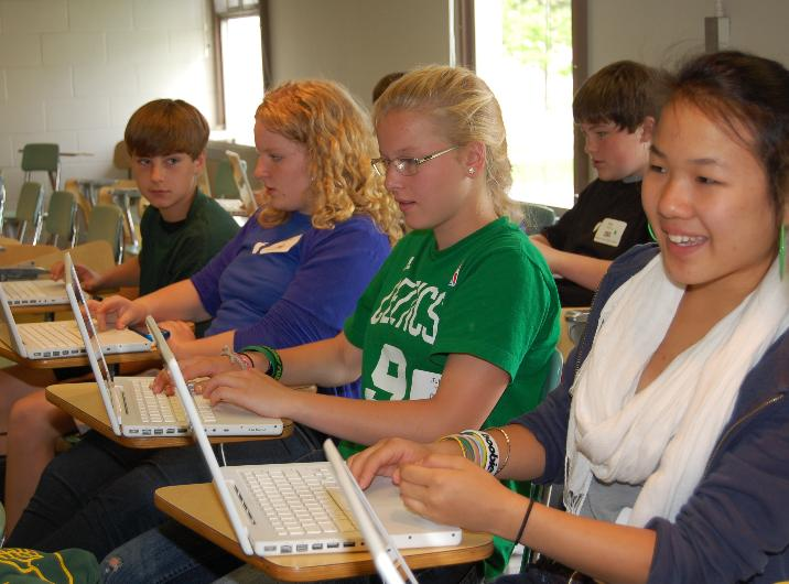 Brooklin School eighth grader Gracie Hylan and her friends learn to record, cut and rearrange sounds using their MacBooks' GarageBand software at the ninth annual Maine learning Technology Initiative Student Conference.