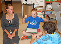 Fifth graders at Farwell Elementary School brainstorm ideas with their teacher, Danielle Bilodeau, for their hands-on Greek mythology project.