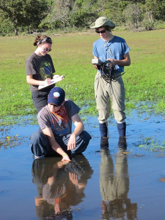 York students Patty McMurray, Andrew Fitzgerald and Todd Brockelman gather water quality data in a freshwater channel of the Pantanal, a region of Brazil.