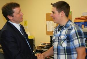Commissioner Stephen Bowen meets Jack Wheeler, recent graduate of the SPICE Family Literacy Program.