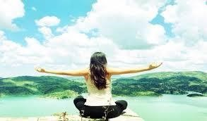 Female sitting with arms wide open before meditating