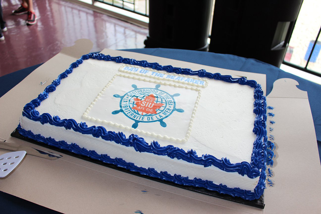 Blue and white cake with the SIU logo, reading: Day of the Seafarer