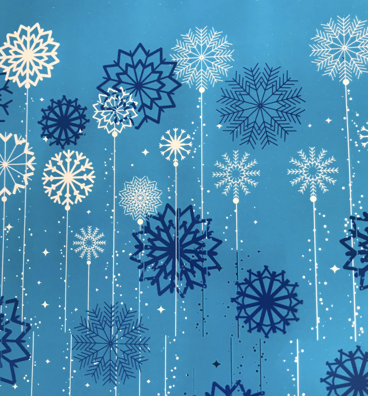 Stylized snowflakes on blue background