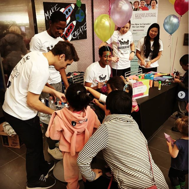 REC students at event with participants and balloons