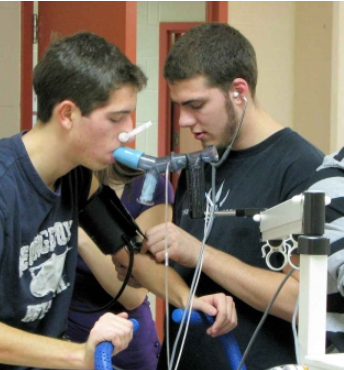 Two students using CP03 Max machine