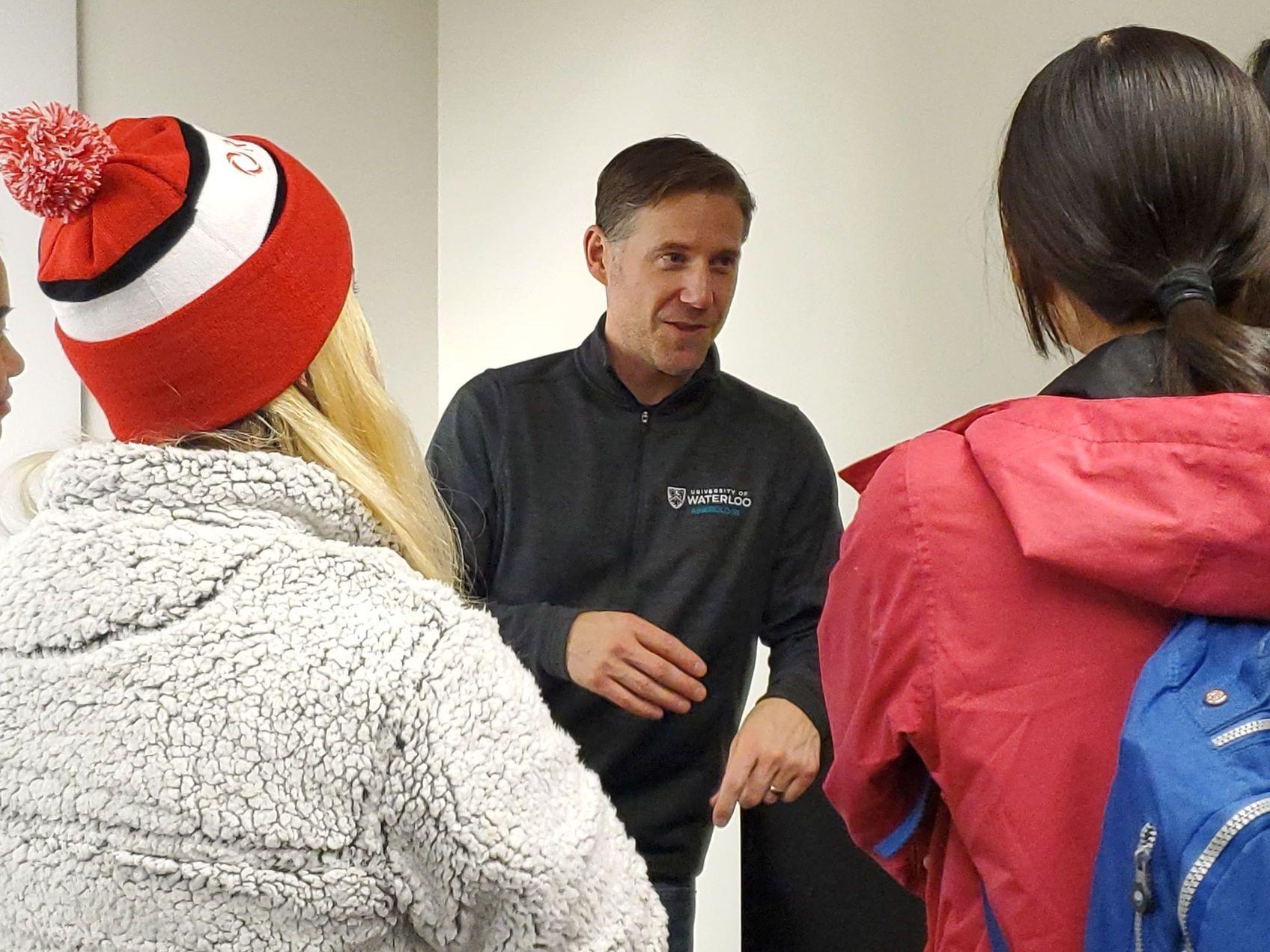 Professor speaking with grad students