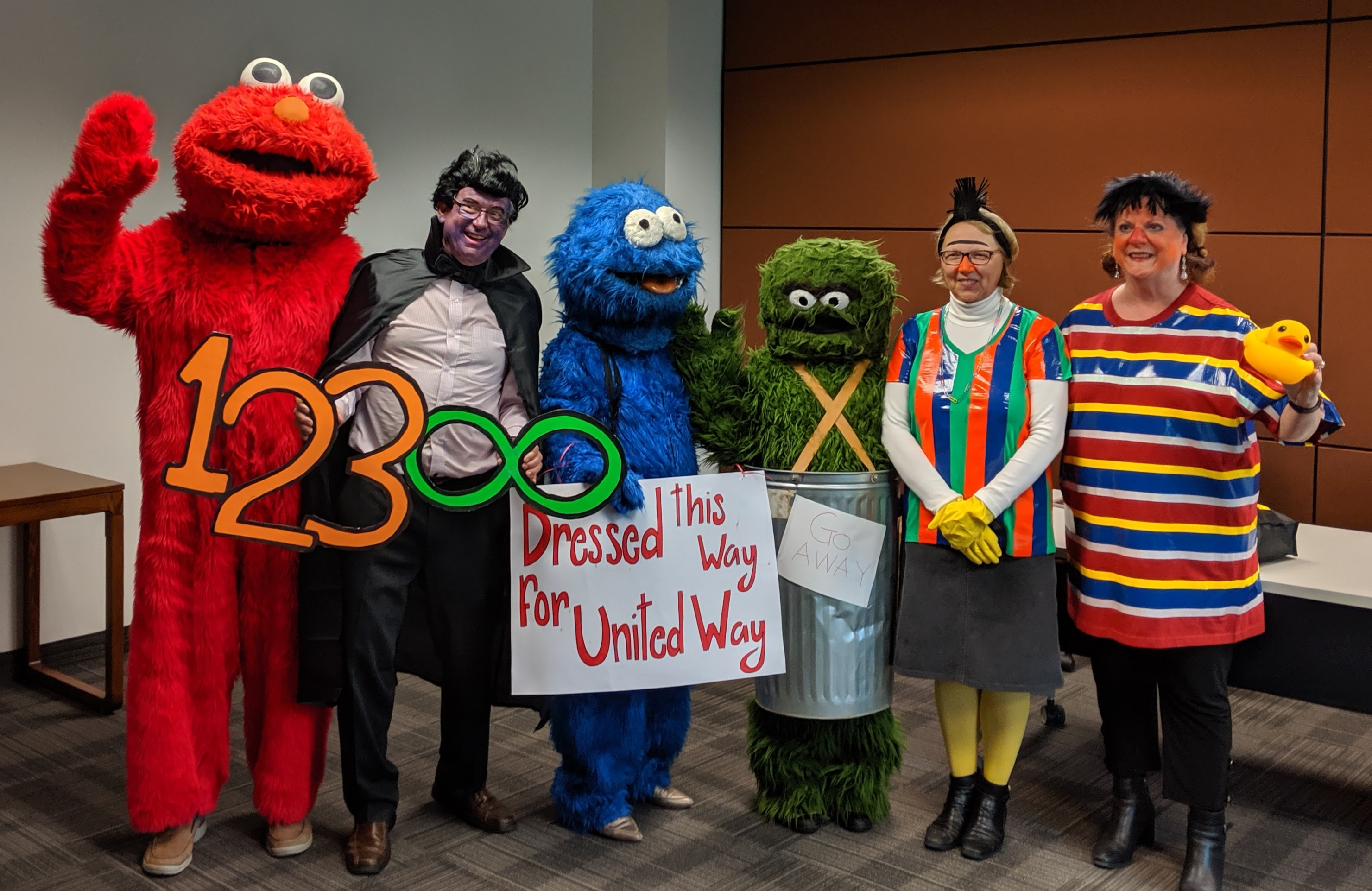 The deans in Sesame Street costumes