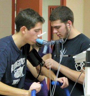 Two young students with breathing apparatus