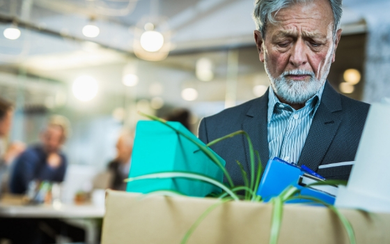 Man leaves work with personal possessions