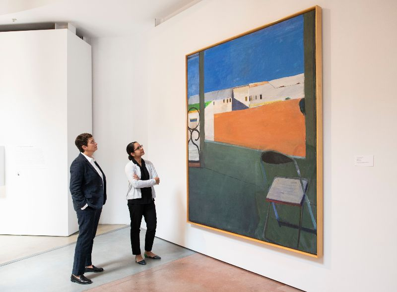 Two people viewing a painting by Richard Diebenkorn at the Cantor Arts Center