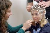Researcher putting a neural net on a child