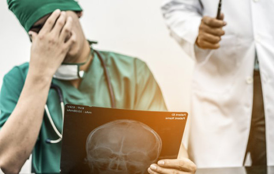 Remorseful doctor by Getty Images