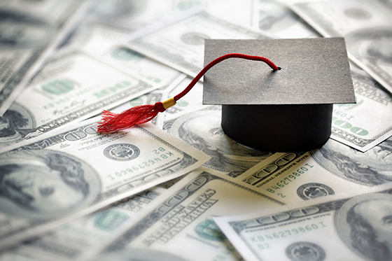 Mortar board with money by Getty Images