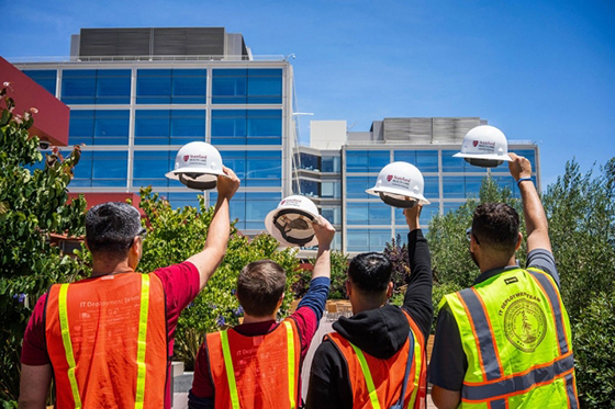 Workers at the new hospital by Darius Riley