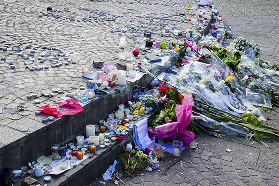 Flowers and candles at a memorial/Getty Images