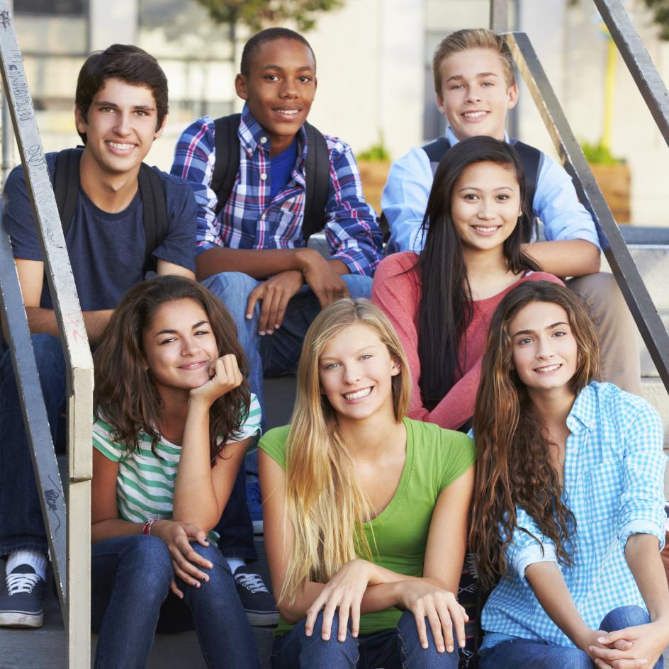 Photo: Students sitting on school steps