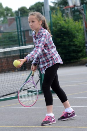 VI Tennis player about to serve the ball at the BBS Have a Go Day in Manchester