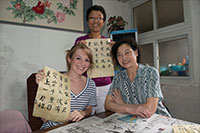 Hannah in Beijing with her tour guide / translator, and a woman who taught Hannah calligraphy. (Photo courtesy of Hannah Curtis)