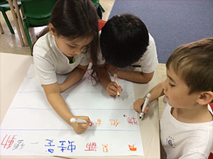 Students work together to write a story.