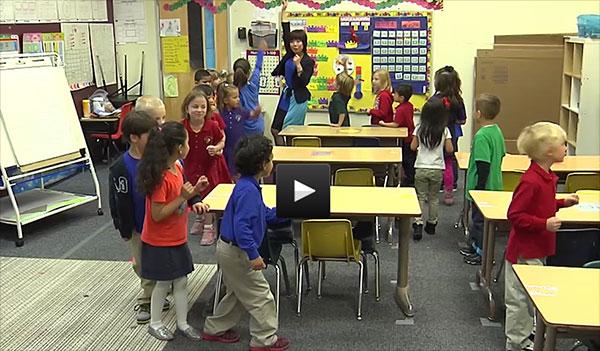 Ms. Xi Sun teaches her kindergarten class in Colorado.