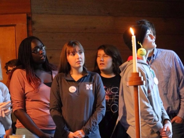 happening participants with candle at worship