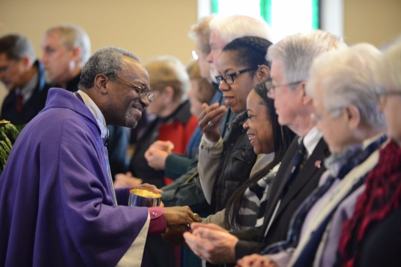 Presiding Bishop Curry serves communion at Grace Church in Syracuse