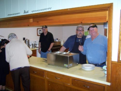 Men making breakfast at St. Ann's Afton