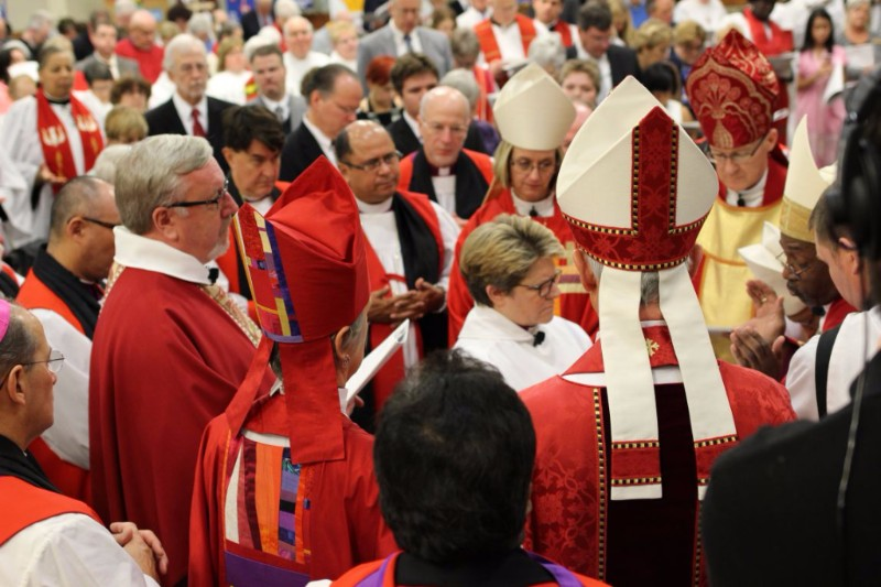 Bishops prepare for laying on of hands.