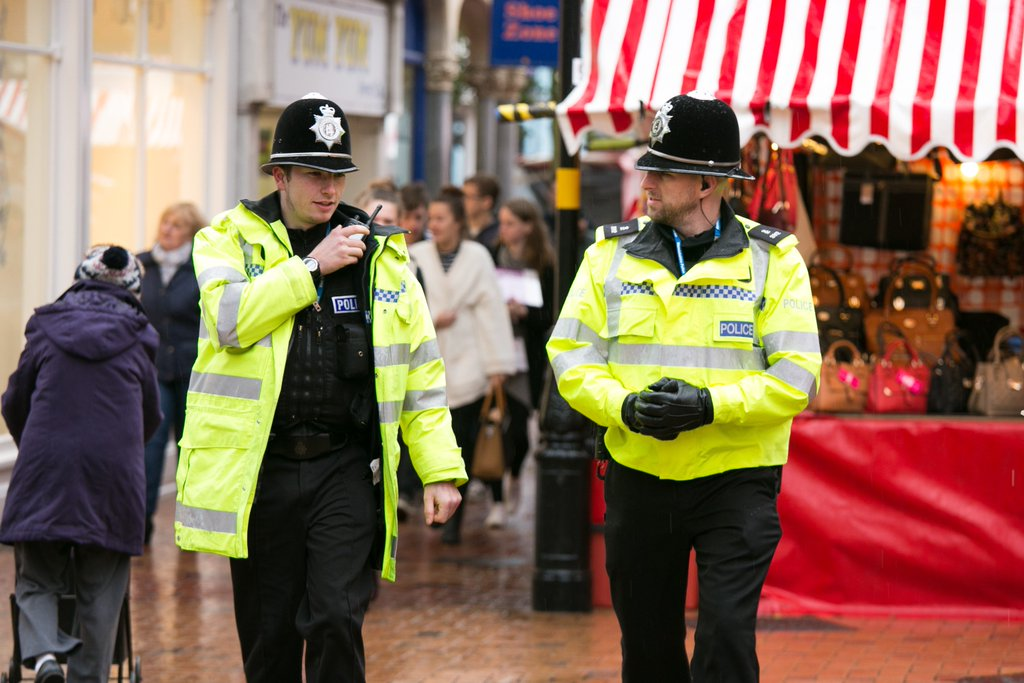 Police officers walking the beat in a town centre
