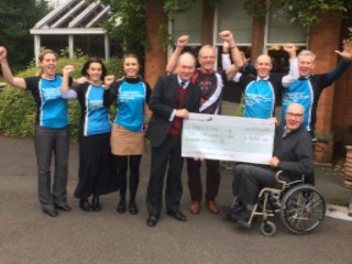 The Warwickshire Wolves present £2100 to Parkinson's UK