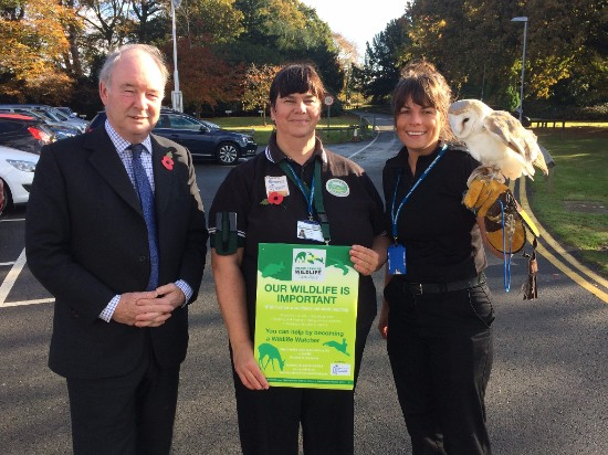 Philip Seccombe, Warwickshire Police and Crime Commissioner with Carol Cotterill, Chair of Warwickshire Rural Watch, and PC Lucy Whatmore from Bedworth Police Station holding one of the owls from the Nuneaton and Warwickshire Wildlife Sanctuary