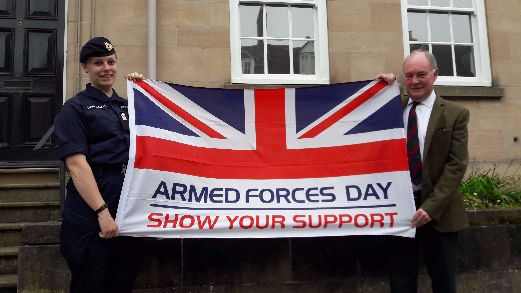 Sgt Vicki Duffield-Smith with PCC Seccombe and the Armed Forces Day flag