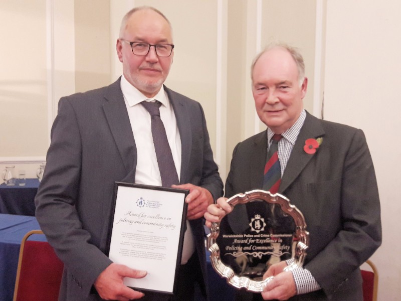 Robin Bunyard with PCC Philip Seccombe and the award