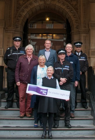 Police, council officials and partners with the Purple Flag award