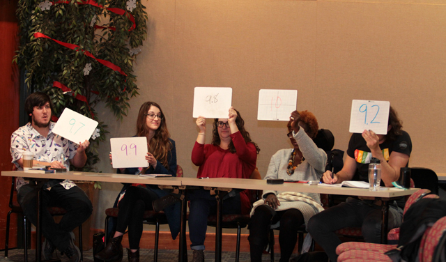 Judges show their scores at the MLK Poetry Slam