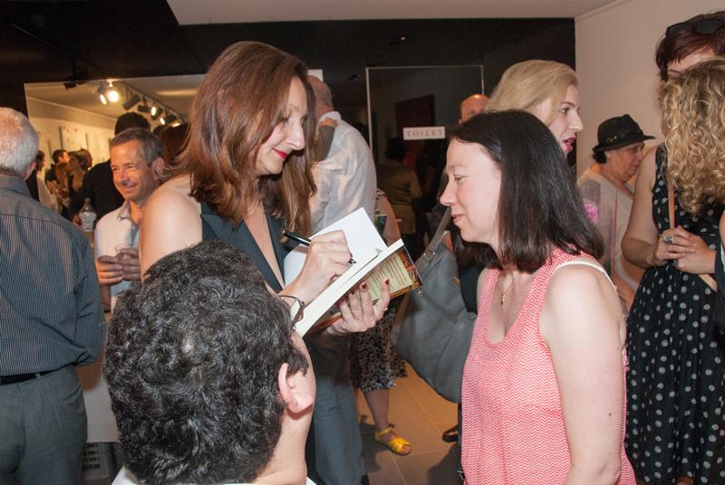 Eva signing books
