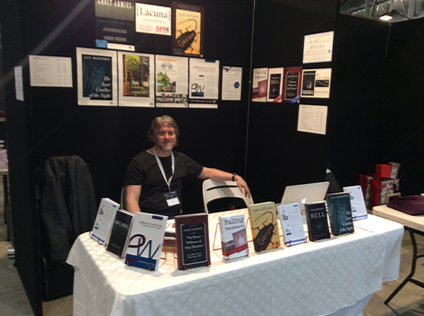 Chris at the Lacuna Publishing stall, Book Expo Australia