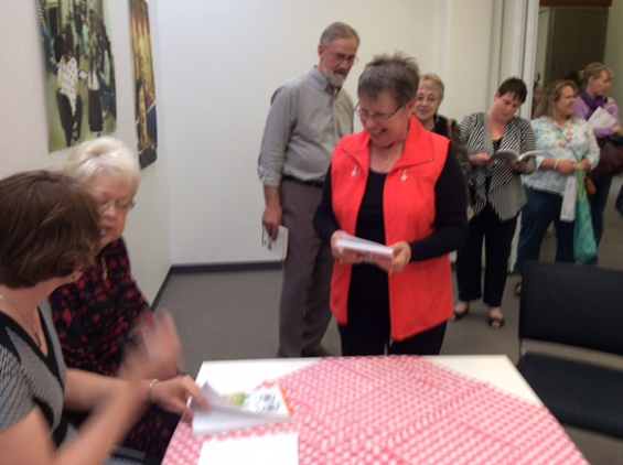 Anne signing books